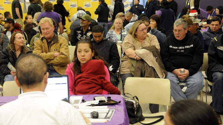 People wait to get help signing up for health insurance coverage through Covered California at the SEIU-UHW office on F Street.