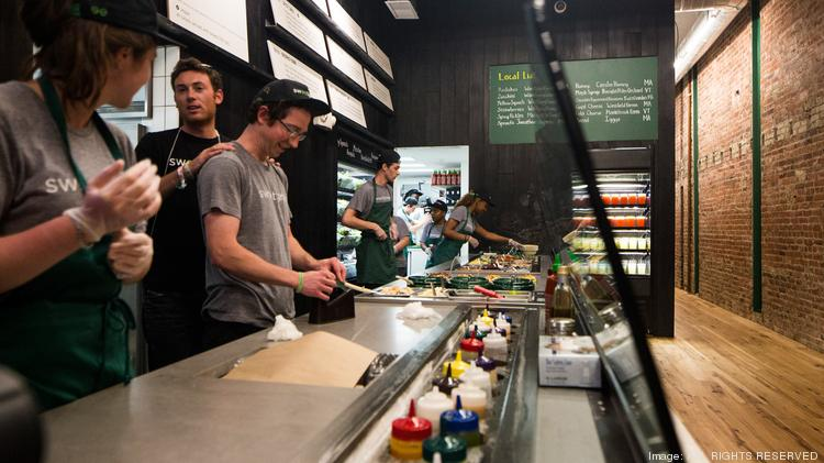 Workers at a Sweetgreen. The salad restaurant is coming to Twelve12 at Capitol Riverfront.