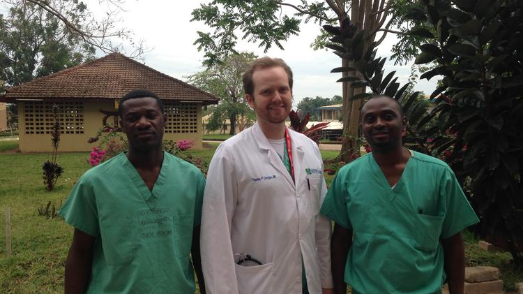 Dr. Thomas Carrigan of St. Elizabeth Hospital in Edgewood, Ky., in Ghana with Dr. Yaw Adu-Boakye and Dr. Lambert T. Appiah of Komfo Anokye Teaching Hospital in the city of Kumasi.