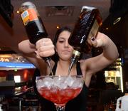 King's Bowl bartender Jenna Gabriel mixes a Tropical Tango, one of the location's signature drinks made for 2-4 people.