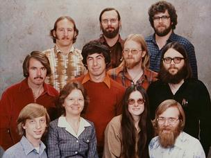Top row: Steve Wood (left), Bob Wallace, Jim Lane Middle row: Bob O'Rear, Bob Greenberg, Marc McDonald, Gordon Letwin Bottom row: Bill Gates, Andrea Lewis, Marla Wood, Paul Allen