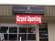 A simple sign announces the Steinway Piano Gallery, which opened recently in a strip mall on the northern outskirts of Bellevue. The grand opening is Sunday, April 6.