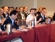 A reporter asks a question during a panel session at the Airline Distribution 2013 conference.