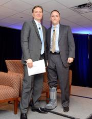 Ralph Kaiser, president and CEO of Universal Air Travel Plan, poses for a picture with Cory Garner, right, managing director of sales operations and distribution for American Airlines.