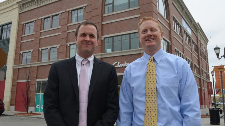 Miles McCune (left) and Jim Gates, office brokers with Kessinger/Hunter & Co. LC, are pictured in front of one of the buildings in Zona Rosa where they are marketing rare available office space.