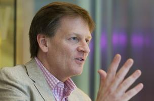 Author Michael Lewis speaks during an interview in New York,  in 2010 has come out with a new book, Flash Boys, which  sheds light on high-frequency trading.