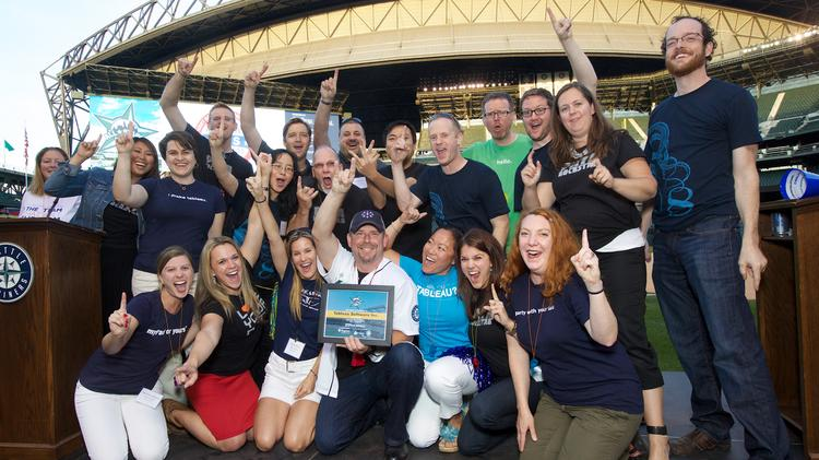 Tableau Software employees celebrate their Gold Medal status in the Extra Large Company division of 2013 Washington Best Workplaces Awards at Safeco Field in Seattle. The company reported revenue growth but a net loss Thursday; its share price soared in after-hours trading.