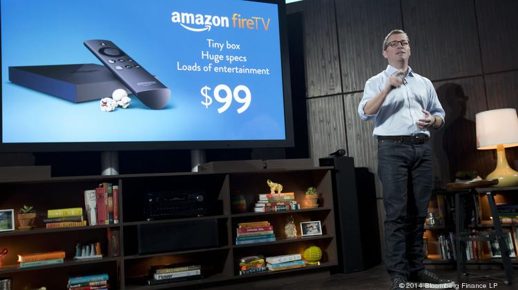 Peter Larsen, vice president of Amazon.com Inc., introduces Amazon Fire TV during a news conference in New York on Wednesday. The world's largest Internet retailer unveiled Fire TV, a television-viewing device for streaming movies, television shows and other video from the Web.