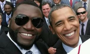 Barack Obama poses with David Ortiz in what was later discovered to be a staged shot courtesy of Samsung.