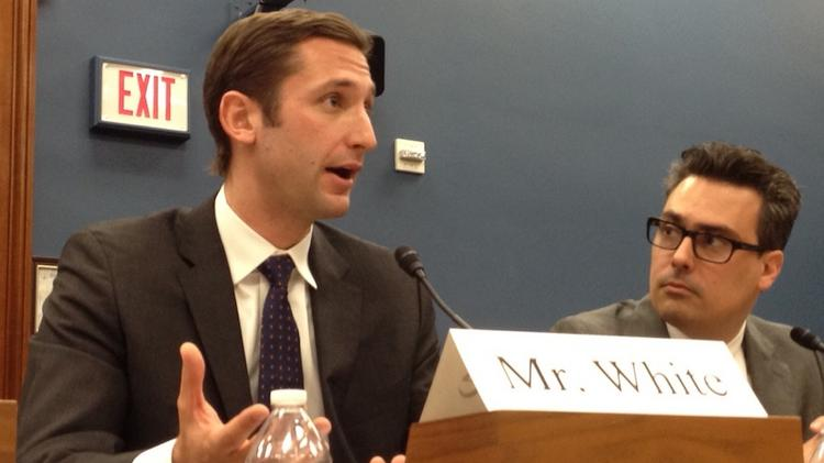 Adam White, director of business development and sales at Coinbase, talks about the benefits of bitcoin for small businesses, at a House hearing as another bitcoin proponent Jerry Brito, a senior research fellow at the George Mason University's Mercatus Center, listens.