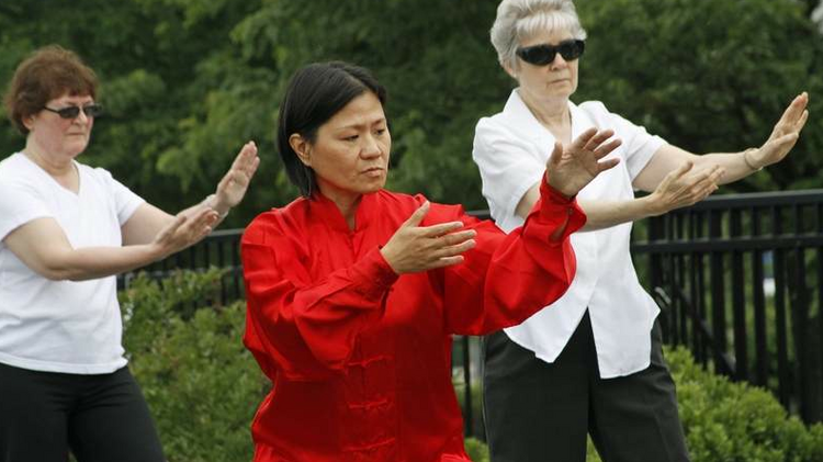 Women practice Qigong, a Chinese practice of aligning the body and meditating using different postures, at Hope Connections for Cancer Support. The Bethesda nonprofit is starting to offer different support groups and programs to cancer patients at local hospitals.