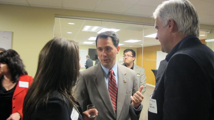 Gov. Scott Walker chats with attendees at the opening of BizStarts' BizForge entrepreneurial hub.