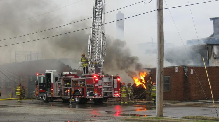 ​A fire in downtown Dayton on Wednesday evening gutted a vacant commercial building and left one firefighter injured.