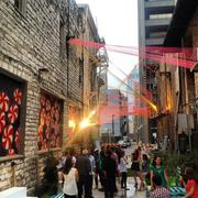 Alley walls can provide unconventional backdrops for public art.