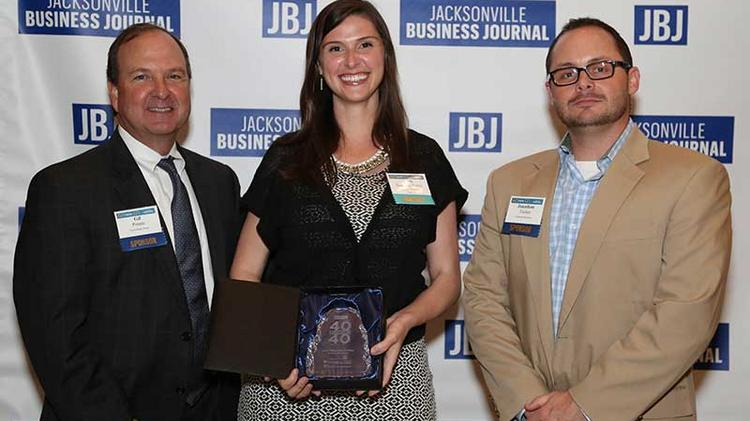 40 Under 40 winner Cari Sanchez-Potter of Intuition Ale Works stands between Gil Pomar and Jonathan Tucker.