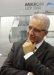Stanislaw Tillich, minister-president of the German state of Saxony, listens during a tour of Simmons Machine Tool Corp., in Menands. Simmons has sister factories in Saxony.