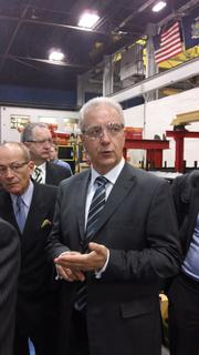 Stanislaw Tillich, minister-president, German state of Saxony, on a tour of Simmons Machine Tool Corp., in Menands