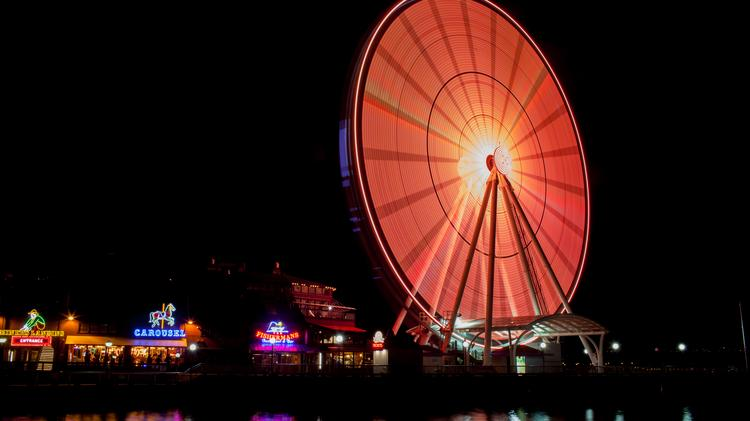 Seattle's Great Wheel turned orange recently to celebrate a two-day Obliteride bicycle ride raising money and awareness for Fred Hutchinson Cancer  Research Center. Other structures will also be orange at night in April.