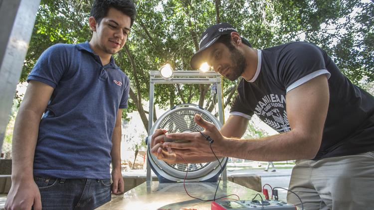 Arizona State University sophomores Cesar Vargas, left, and Mohammed Alawaji work on a class project that deals with harnessing a form of renewable energy.