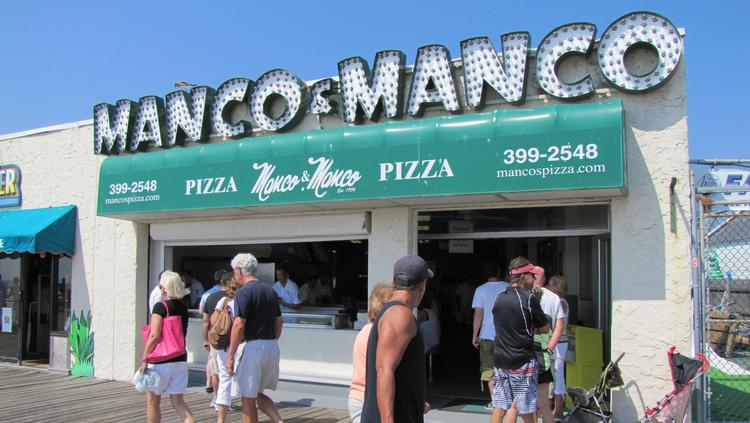 The owners of Manco and Manco pizza have been charged with defrauding the IRS of $1 million.