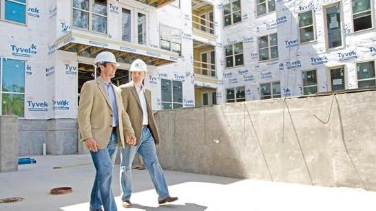 Alamo Manhattan President Matt Segrest, left, and Vice President Wade Johns inspect the site of the luxury Uptown residential project in 2013 near Victory Park.