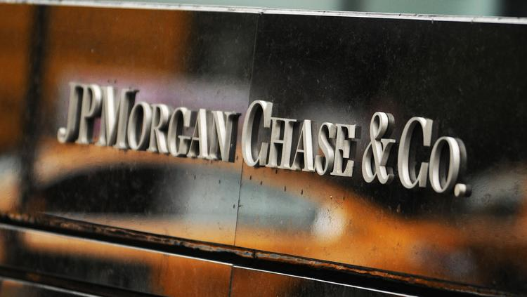 The JPMorgan Chase & Co. sign stands outside the company headquarters on Park Avenue in New York.