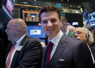 Matt Maloney, co-founder and chief executive of GrubHub, right, stands for a photograph while waiting for the initial public offering (IPO) listing on the floor of the New York Stock Exchange (NYSE) in New York,  on Friday, April 4, 2014.
