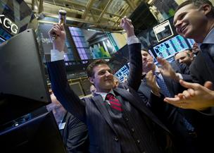 Matt Maloney, co-founder and chief executive of GrubHub Inc., center, reacts after the initial public offering (IPO) listing on the floor of the New York Stock Exchange (NYSE) in New York on Friday, April 4, 2014.