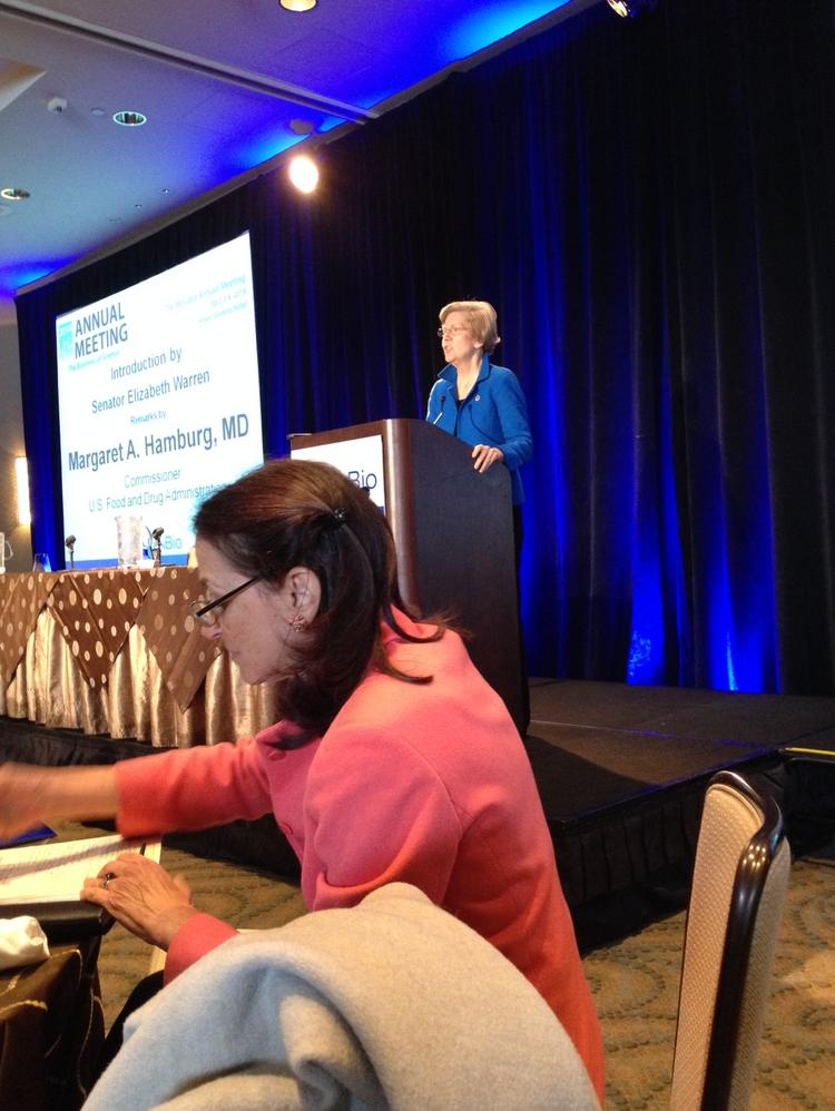 FDA Commissioner Margaret Hamburg, foreground, was introduced as the closing speaker today at MassBio's annual meeting by Sen. Elizabeth Warren.