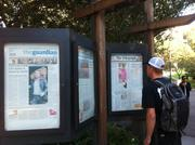In front of Moffitt Library, passersby can stop to read an ironic, anachronistic display of oversize front pages of global newspapers.