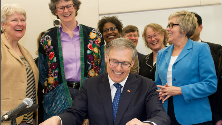 Gov. Jay Inslee signs one of three health bills approved by the Washington Legislature in ceremonies at Harborview Medical Center in Seattle on Friday.