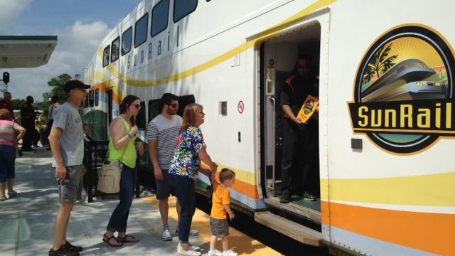 Crowds ready to board SunRail at the new Lake Mary train station.