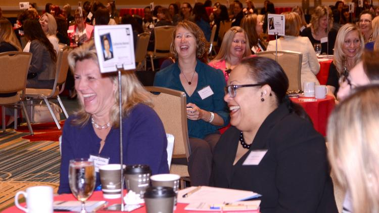 Central Florida businesswomen shared a lighthearted moment as the first Bizwomen Mentoring Monday began at the Hilton Orlando.