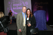 Business Journal editor Rob Smith stands with Orchid Award winner Angie Galimanis of Lane PR.