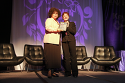 Deena Pierott of Mosaic Blueprint (left) accepts her Orchid Award from Business Journal director of events Stephanie Torres.