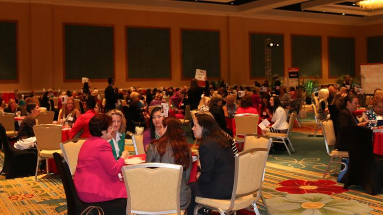 Business women filled the room at Hilton Orlando as 42 tables were set up for a speed dating-styled event geared toward mentoring women and their careers.