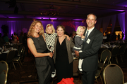 Nonprofit Executive of the Year Sheila North (center) of De Paul Treatment Centers poses with son Alec Smith and his family.
