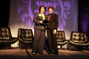 Health Share of Oregon's Janet Meyer (left) accepts her Orchid Award onstage from Business Journal director of events Stephanie Torres.