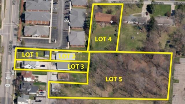 Gryphon Auction Group and Borror Properties are marketing three residential properties and 1.6 acres of vacant land in New Albany.