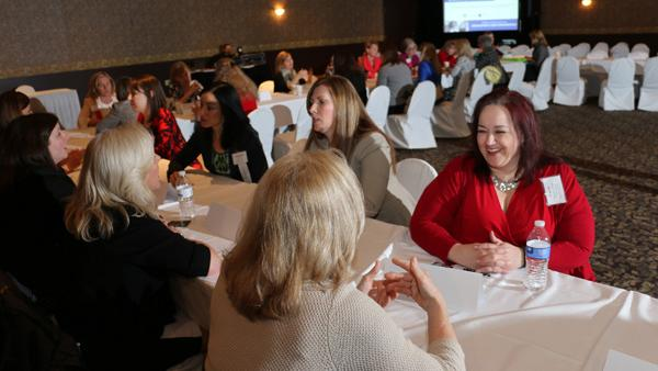 Women talk with their mentors at the Business Courier's first-ever mentoring Monday.