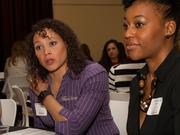 Rachel White-McQuillen, Westar Energy, and Christina Long, MSlady LLC, talk with mentors during Monday's Mentoring Monday event.