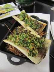 Marrow bones with a rye-infused herb crust is one of the bar snacks for the Rye Bar at the Capella Hotel.