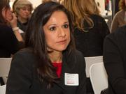 Sylvia Penner, Fleeson Gooing Coulson & Kitch LLC, listens to the conversation at her Mentoring Monday table.