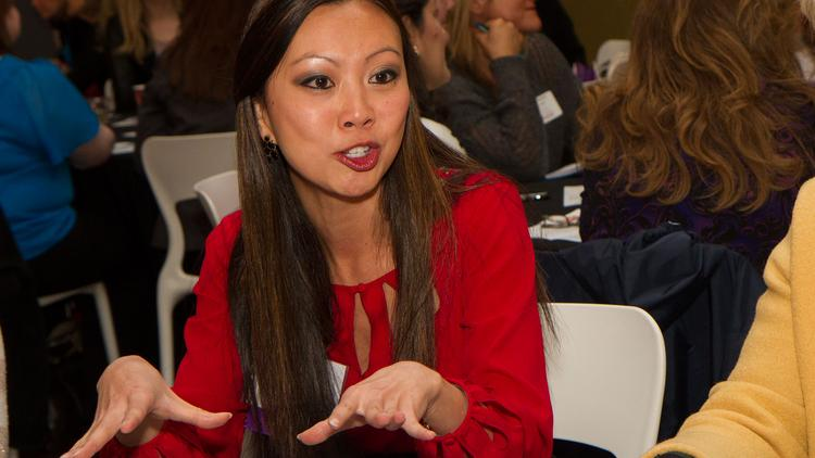 Lily Wu, KAKE TV, talks to businesswomen at the WBJ's Mentoring Monday event.