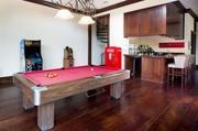 An entertainment room with a billiard table. The mansion features two game rooms.