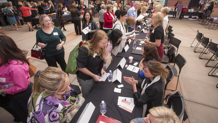 Attendees and mentors lined up around the room during the speed mentoring part of the inaugural Bizwomen Mentoring Monday event earlier this year in Phoenix.