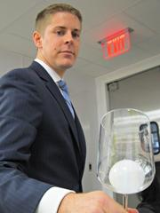 Food and beverage manager Will Rentschler shows off the finished ice ball.