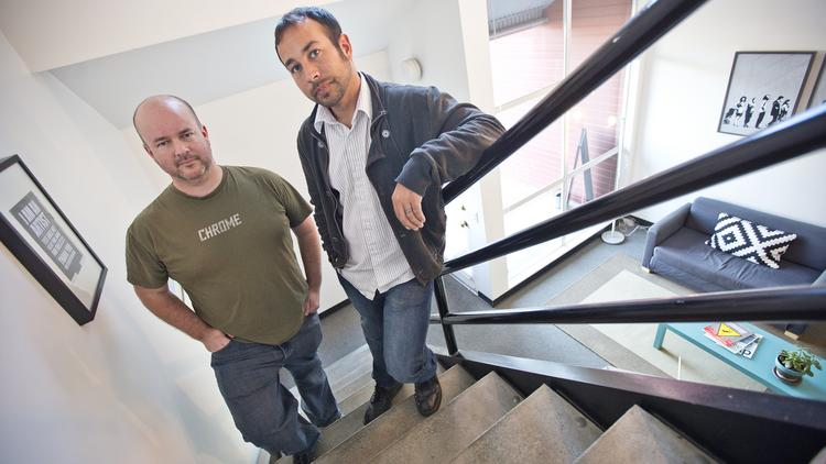 PayStand co-founders Scott Campbell (left) and Jeremy Almond in their Santa Cruz office. The startup has raised $1 million to help reach businesses, charities and other organizations looking for flexible payment options.