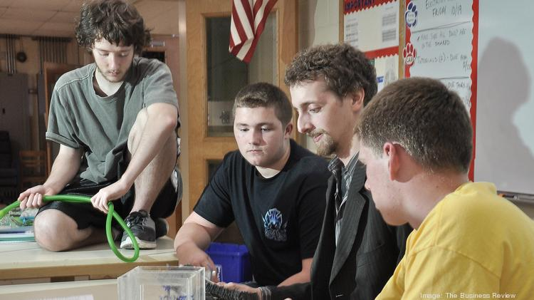 Students from Maple Hill High School in the Schodack Central School District work with Brent Solina, co-founder of MICROrganic Technologies, a startup company that operates out of the school's growing business incubator.