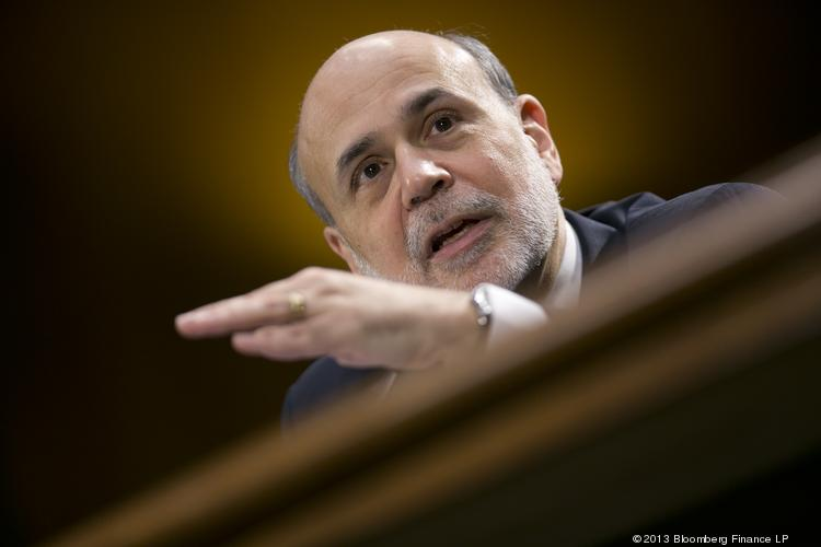 Ben Bernanke, chairman of the U.S. Federal Reserve, speaks during a Senate Banking Committee hearing in Washington, D.C., on Tuesday. Bernanke defended the central bank's unprecedented asset purchases, saying they are supporting the expansion with little risk of inflation or asset-price bubbles.